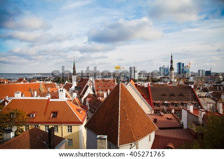 Red roofs of the old houses of the historic centre of Tallinn, Estonia. Top view of European city Tallinn. The ancient architecture. Roof with wings. - stock photo