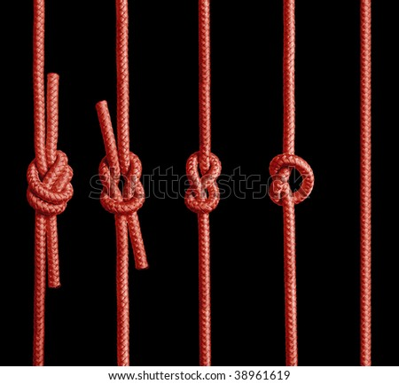 Red rope with knot. - stock photo