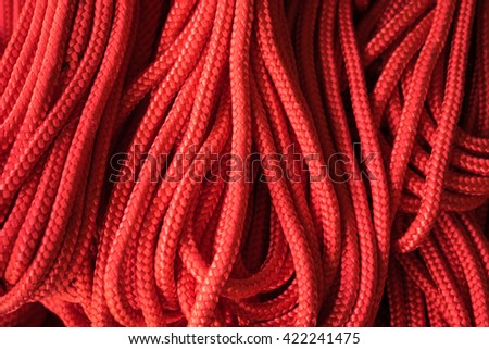 Red ropes for background - stock photo