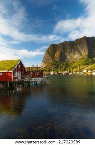 Red rorbu huts on Lofoten Island Norway - stock photo