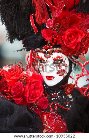 Red rose and black costume at the Venice Carnival - stock photo