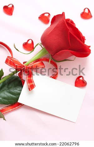 red rose and blank card - stock photo