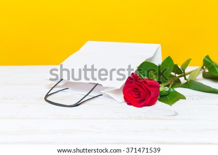 Red rose and gift packages