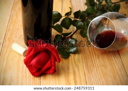 Red rose and glass of wine - stock photo