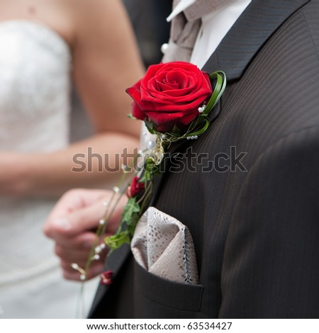 red rose on the clothes of the bridegroom