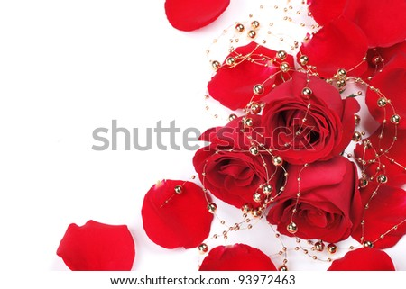 Red rose petals with beads isolated on white.