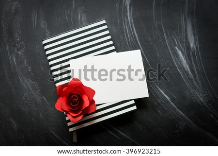 Red rose with blank paper. Copy space. - stock photo