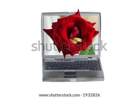 Red rose with gold rings coming out of a computer - stock photo
