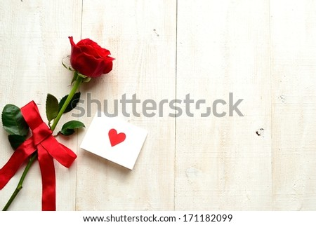Red rose with message card.Image of Valentines day. - stock photo