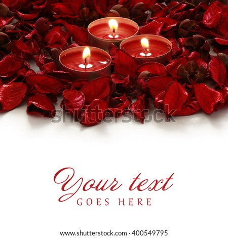 red roses and candles on whiter background with space for your text - stock photo