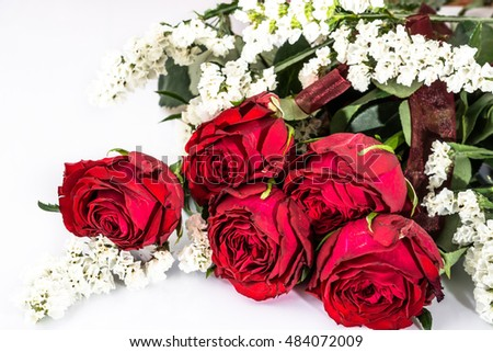 Red roses bouquet cut flowers on white background