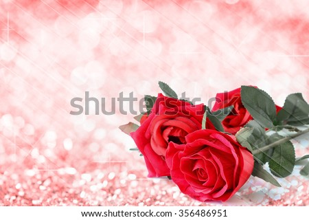 Red roses bouquet with bokeh and free space for text, valentine twinkled bright background. - stock photo