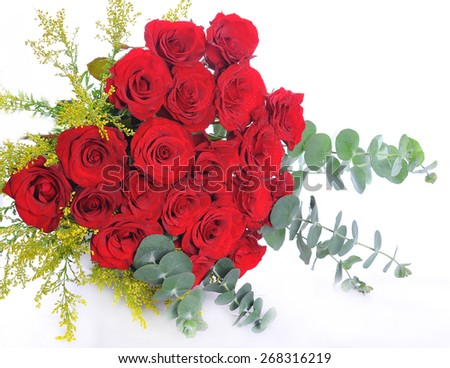 Red roses bouquet with leaves - stock photo