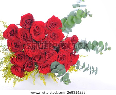 Red roses bouquet with leaves