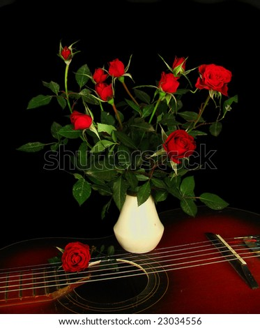 red roses,guitar - stock photo