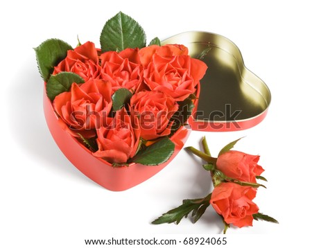Red roses in a heart-shaped box