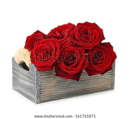 Red roses in a wooden box isolated on white background - stock photo