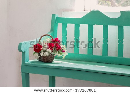 red roses on bench indoor - stock photo