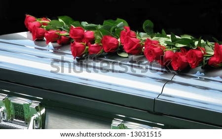 red roses on casket - stock photo