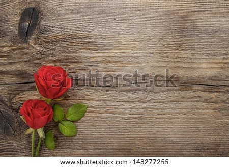 Red roses on wooden table. Blank board, copy space - stock photo