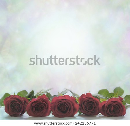 Red Roses Poster Background - Five Red Roses facing head-on at the bottom of a misty pale green bokeh background with lots of copy space