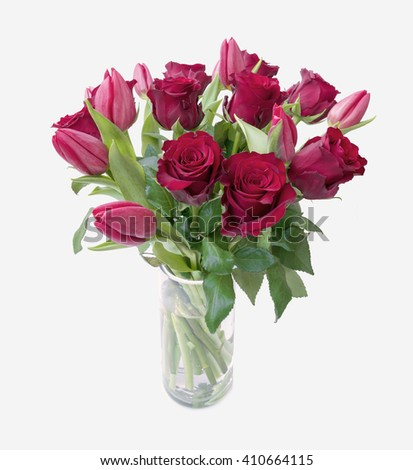 Red Roses Red Tulips  in a Glass Vase on isolated white background - stock photo