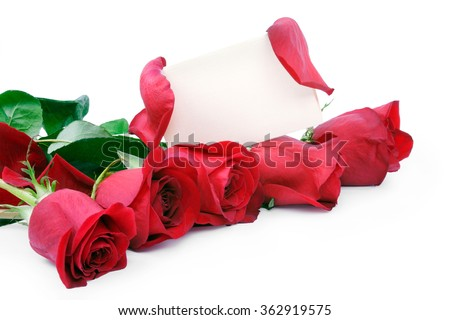 Red roses with a blank gift card on a white background - stock photo