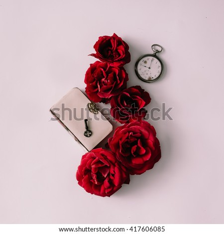 Red roses with white book, key and watch. Love concept. Flat lay.