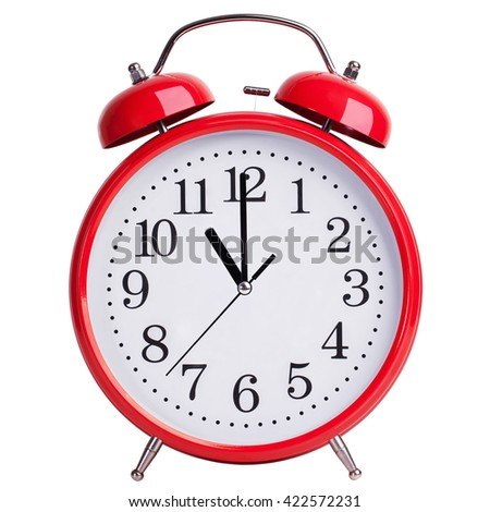 Red round alarm clock shows exactly eleven - stock photo