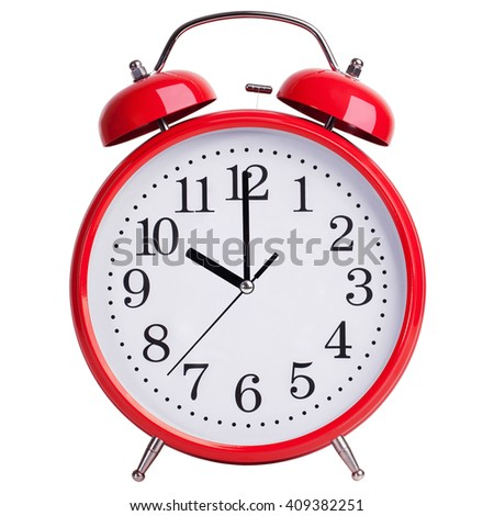 Red round alarm clock shows exactly ten