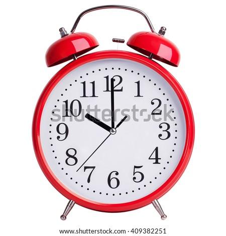Red round alarm clock shows exactly ten - stock photo