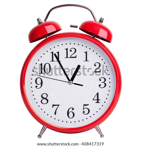 Red round alarm clock shows five minutes to an hour - stock photo