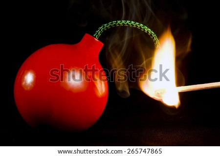 Red Round Bomb Being Lit With Smoke On Black Background/ Fuse Lit And Ready To Explode - stock photo
