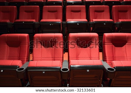 Red rows of theater seats - stock photo
