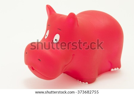 red rubber hippopotamus toy on white background