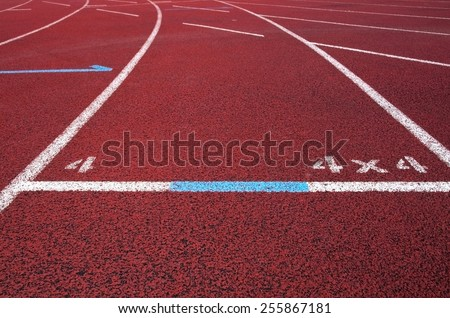 Red running field track with arrows and lines.  - stock photo