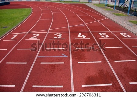 Red running racetrack on the outdoor athletic stadium