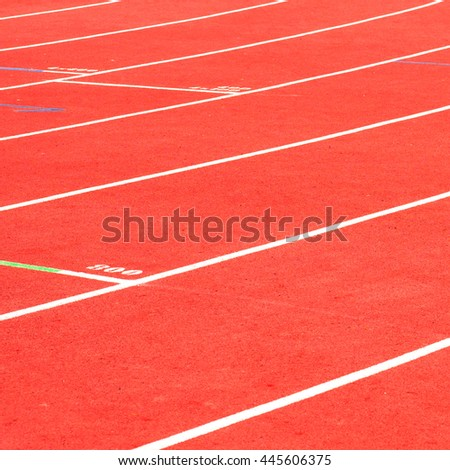 Red running track background on the athletic stadium.