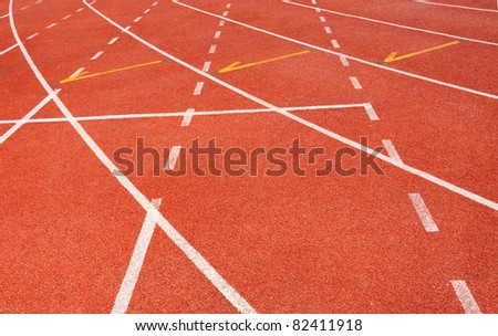 Red running track for athletes - stock photo