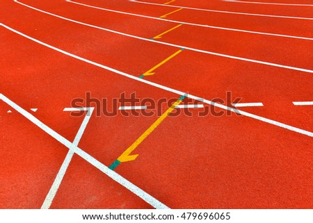 Red running track in stadium. Running track on blue sky.