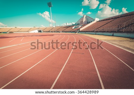 Red running track in stadium , vintage - stock photo