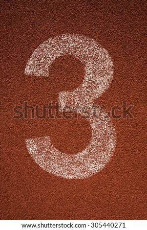 Red running track lane number 3 - stock photo