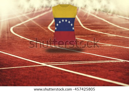 red running track with lines and Venezuela flag on shirt