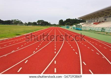 red running tracks in sport stadium - stock photo