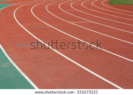 red running tracks in sport stadium - stock photo