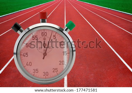 Red running tracks in sport stadium with vintage stop watch in foreground - stock photo