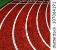 red running tracks with white start numbers at stadium closeup - stock photo