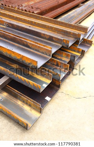 Red rust steel channel in warehouse.