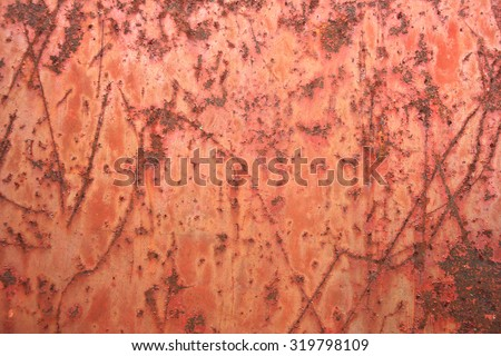 red rusted metal, vintage textured background with scratches and scrapes in peeling paint, old distressed weathered background - stock photo