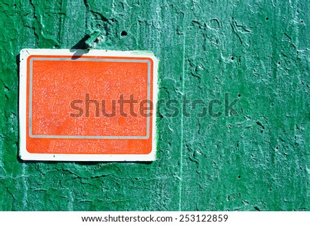 Red rusty grungy old plastic sign on a cement wall - texture with rain droops background, ready for your text - stock photo